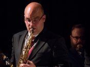 Olly Wilby performin with The Gordon Campbell All Star Octet at Fleet Jazz Club on 19th June. Photograph courtesy of Michael Carrington (from the Aldershot, Farnham & Fleet Camera Club).